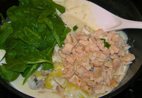 Adding the Chicken and Spinach to Alfredo and Artichokes