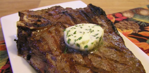 Melting Herbed Butter on Steak