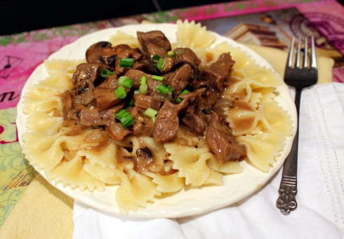 Beef Sirloin Tips with Mushrooms over Hot-Buttered Noodles
