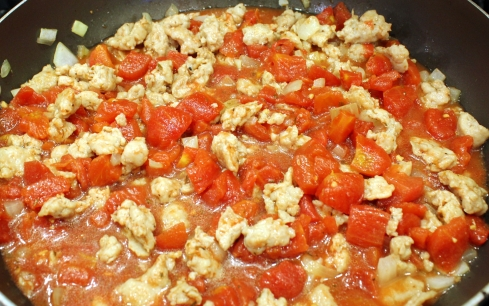 Tomatoes Added to Chicken Sausage Mixture