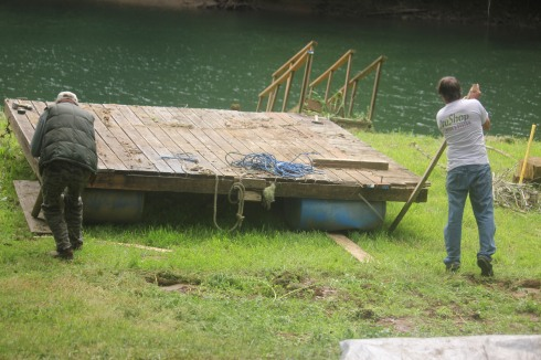 Pushing dock into the river