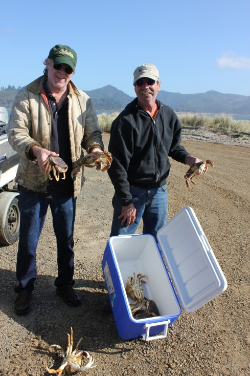 Neighbor and hubby showing off the Dungeness crab